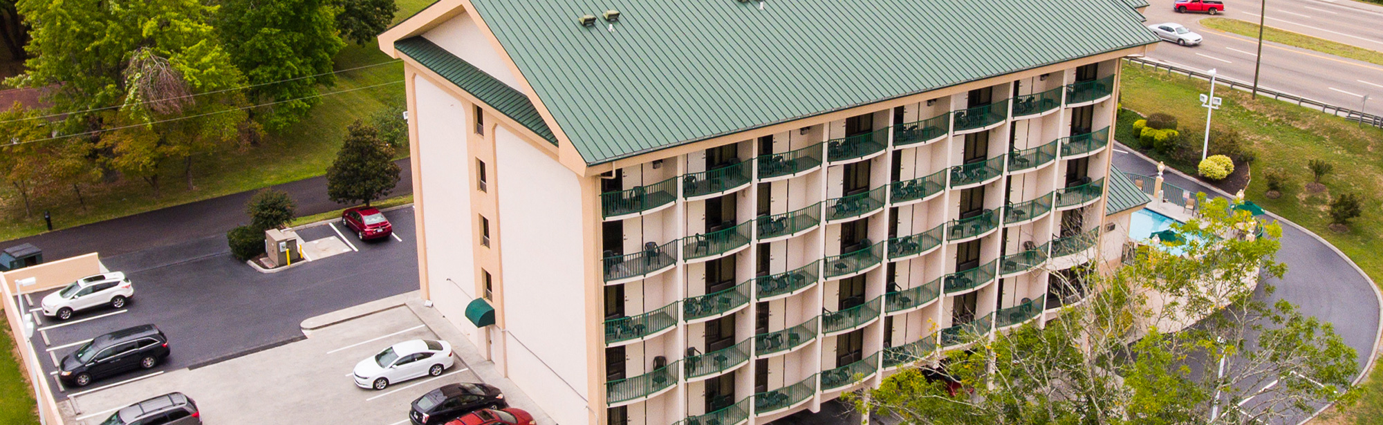Hotel with balconies next to Pigeon River